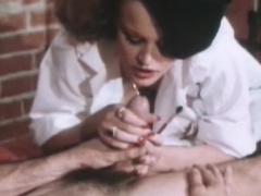 Big-tit brunette gives a deep blowjob