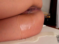 Tasty babe tied to massage table