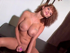Curly-haired mom Joslyn James shows her fake tits