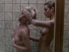 Alluring blonde with natural boobies is washing