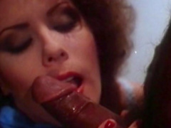 Curly-haired lady is sucking a big black dick
