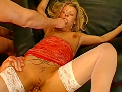 Slender blonde gets shots from two hard dicks