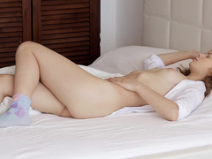 Curly babe Ksenija A is masturbating after waking up