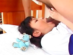 Smiling Asian babe An Mizuki is getting fucked in her mouth