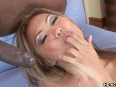 Sweet blonde Lana Croft is riding on the black dick