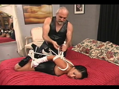 Hogtied Asian girl in corset