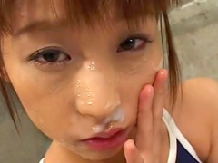 Asian schoolgirl being covered with sperm