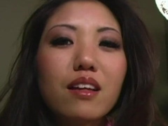 Asian brunette is giving a lovely blowjob