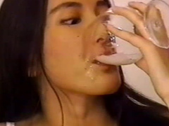 Japanese slut swallows cum from a glass