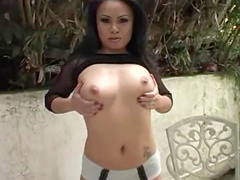 Dark-haired babe is sucking a big dick