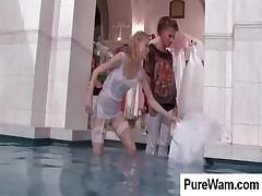 Lesbo bride getting wet in pool