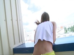 Cute teen on a balcony