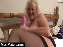 Nasty granny fucking dildo in bedroom