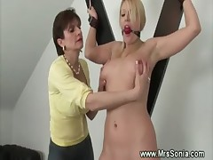 Mistress dominating blond with her machine