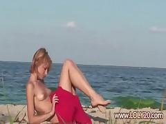 Shy nude girl on the beach