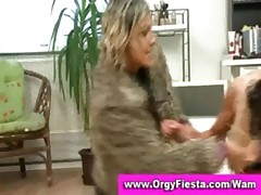 Two glamorous wam ladies have wet and messy fight