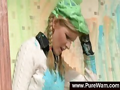 Clothed girls painting each other