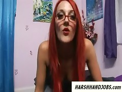 Hot redhead with glasses gives harsh handjob