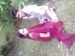 Indian couple fools around in the grass