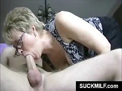 Mature hoe in glasses eats cock