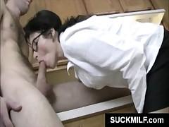 MILF in glasses eats dick in kitchen