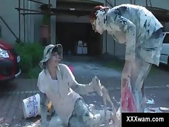 Wild angry sluts go messy with a paint fight outdoor