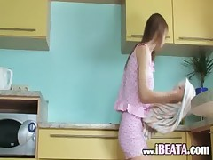 Pussy posing and dildoing in kitchen