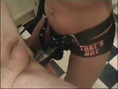 Mistress strap-on fucks slave in gyno chair