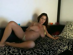 Big tits Ivana in yellow lingerie uses fake penis