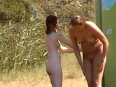 Women filmed on nudist beach
