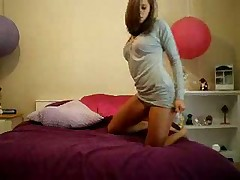 Striptease in front of her webcam