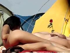 Teasing on a nudist beach