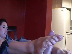 Lots of oil as she gives footjob