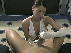 White satin gloves girl gives handjob