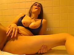 Mature busty masturbating