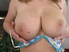 Sara Stone in lingerie plays with her big tits
