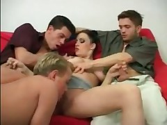 Greedy vixen enjoys three big throbbing cocks
