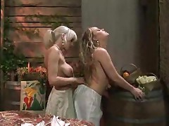 Horny blonde giving oral sex to girl in lesbian scene