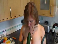 Mature play with herself in kitchen