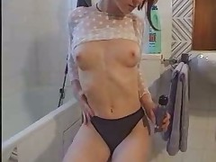 Young redhead rubbing clit on toilet