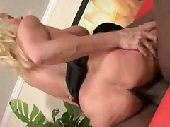 Hot blonde having interracial sex