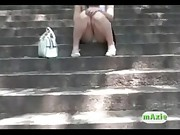 Japanese girl wets panties outside on stairs