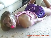 Gagged chick in bondage with dildo
