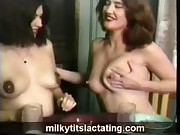 Girls milking their tits at the table and collecting it in a glass