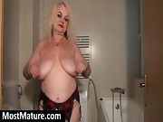 Nasty granny showing fat melons