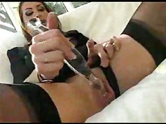 Slut in stockings fucking herself by sex toy