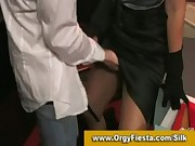 Fully clothed brunette gives blowjob